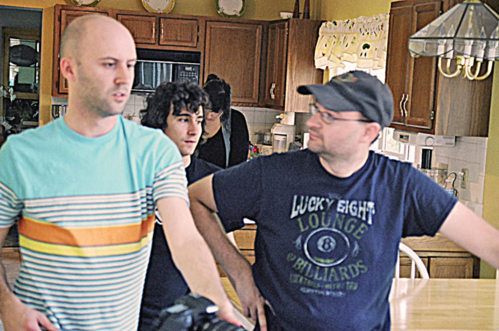 Cinemetographer ROBBIE STUTTLER discusses the next shor with Director R. DAVID BURNS on the set of THE ENVELOPE