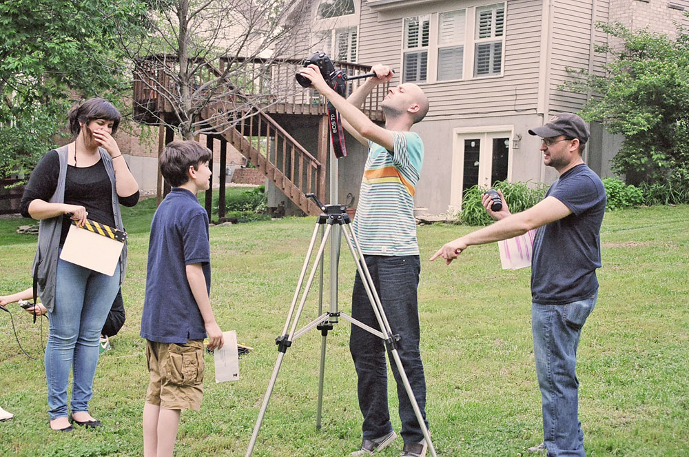 Outdoors filming - Director R. DAVID BURNS instructs star MAX POFF on the upcoming scene for THE ENVELOPE
